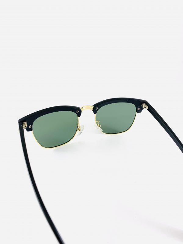 Stilrena solglasögon med mörkt glas