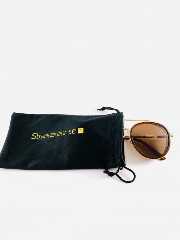 Pilotbrillor i guld och brunt och polariserande glas samt förvaring
