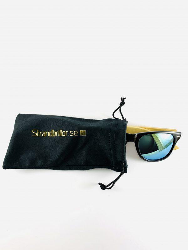 Solglasögon med träbågar i bambu och förvaringspåse