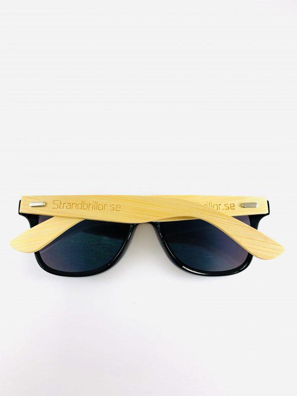 Solglasögon med bågar i bambu