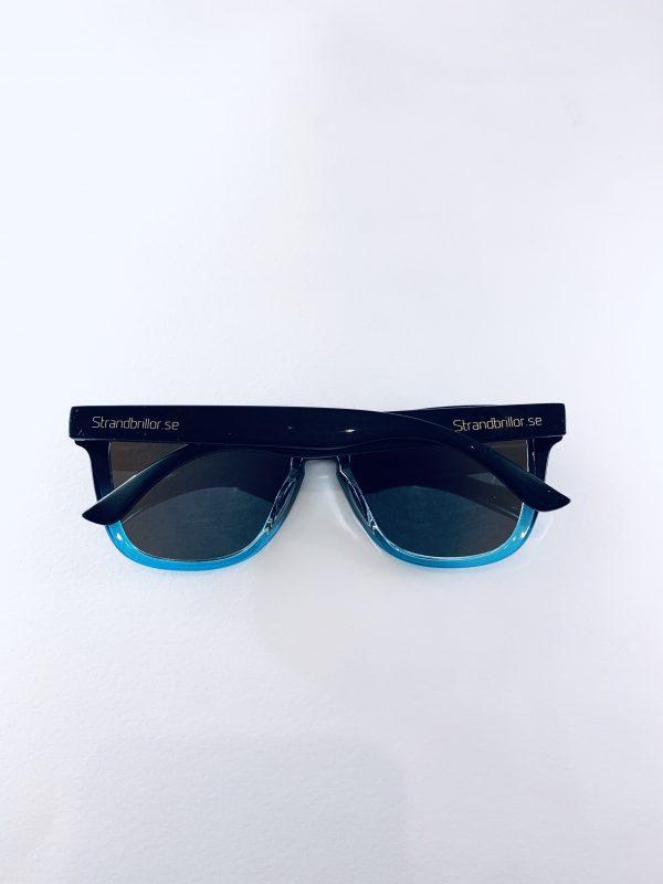 Deeros Solglasögon med blanksvarta bågar UV400 skydd